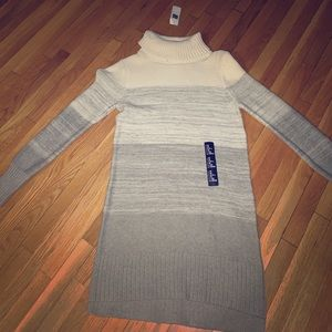 Its a dress and it has a small turtle neck.